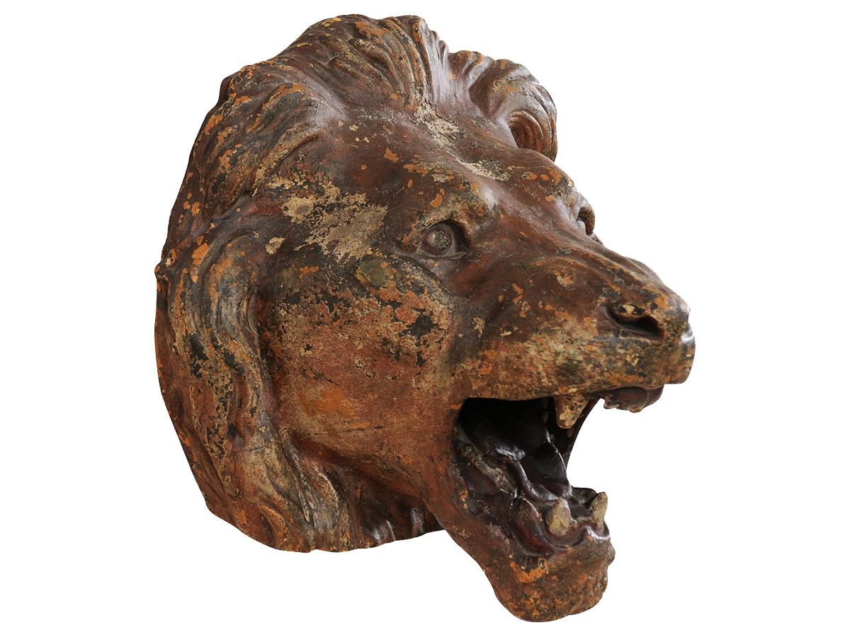A Terracotta Lion's Head Wall Plaque