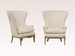 A Pair of Wood Wingback Chairs