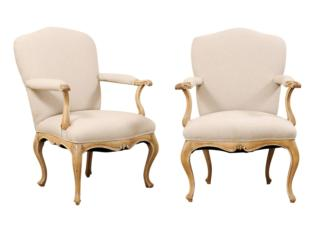 A Pair of Upholstered Arm Chairs
