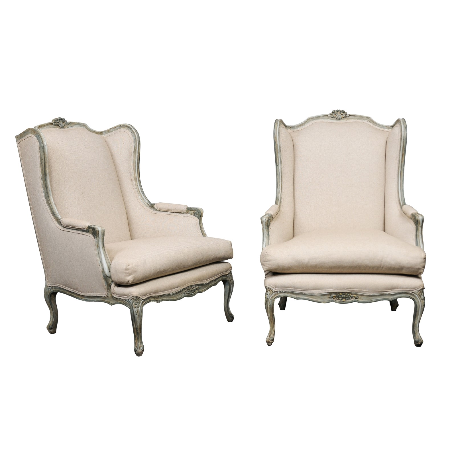 A Pair Of French Wingback Chairs