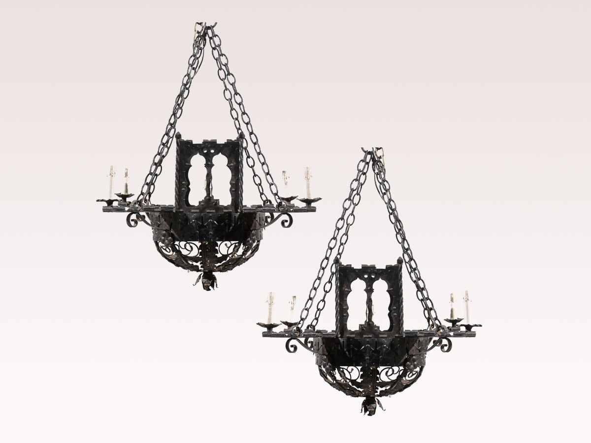 A Pair of Forged Iron Chandeliers