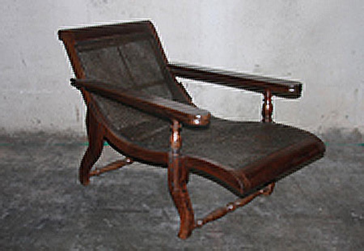 A British Colonial Wooden Lounge Chair