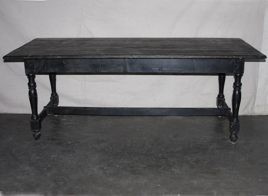 An Antique Black Painted Wood Table