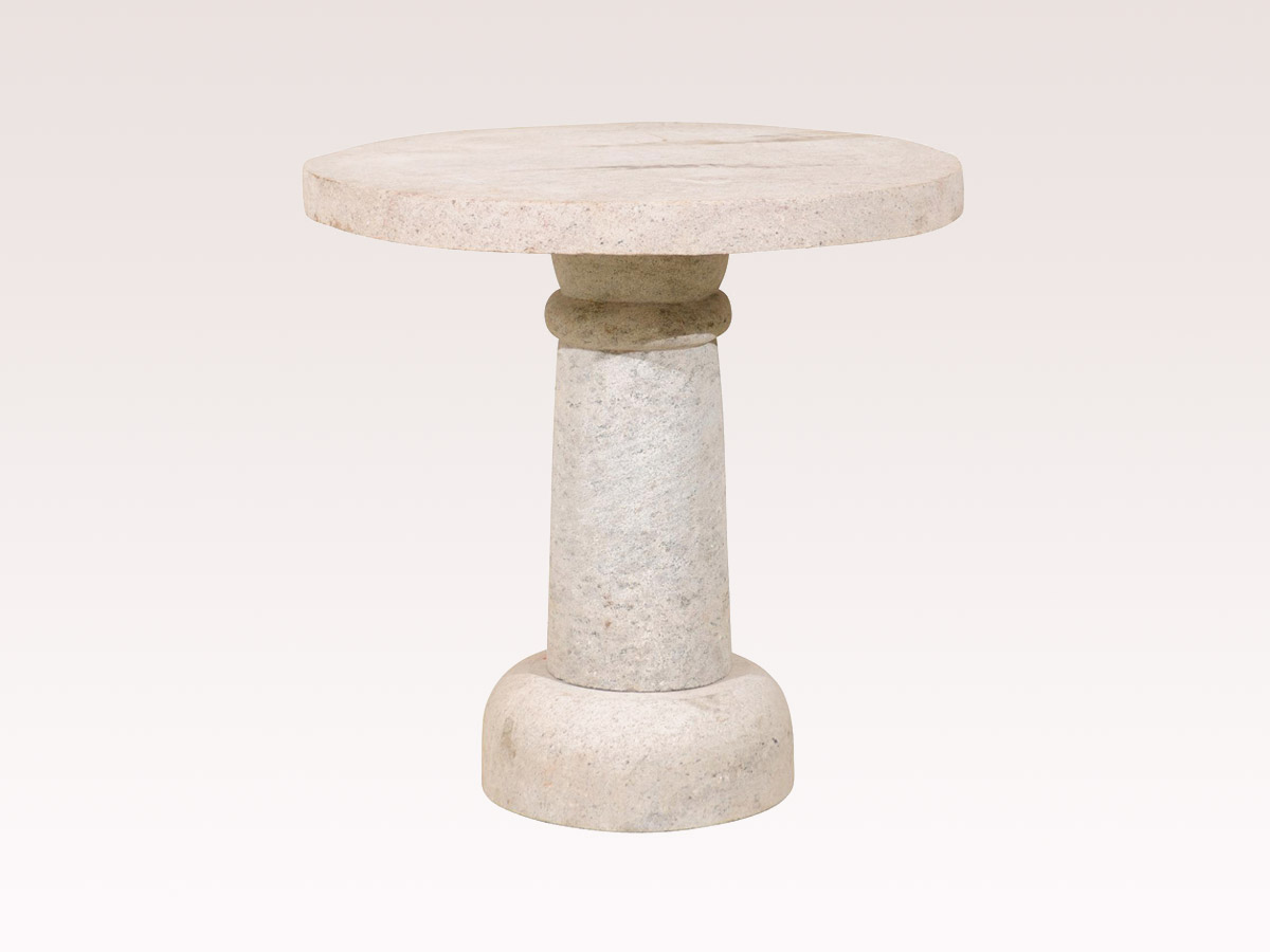 A Round Granite Pedestal Table